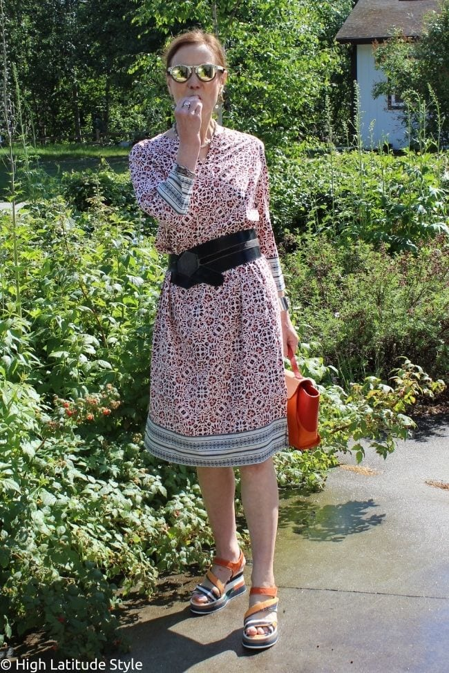 influencer in ethnic dress, DIY belt, wooden mirrored sunglasses, orange bag