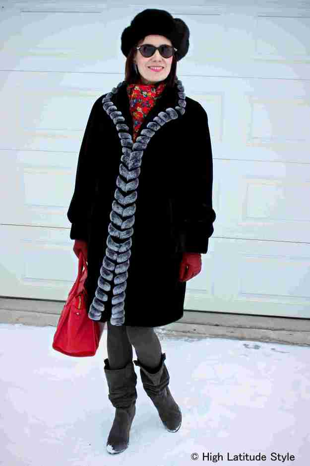 over 50 years old woman in classic winter outerwear for the commute from the office to a business dinner