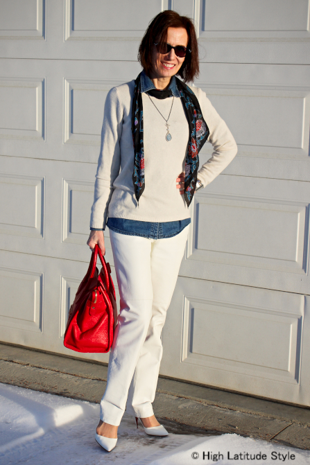 #styleover40 #fashionover50 midlife woman wearing a denim shirt under a sweater accessorized with pearl pendant necklace