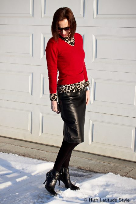 styist in leopard red and leather outfit
