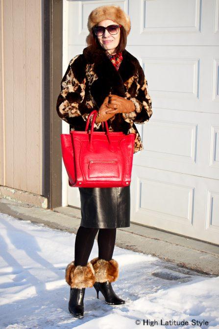 fashion blogger in diamond leopard print jacket with head band and boot toppers