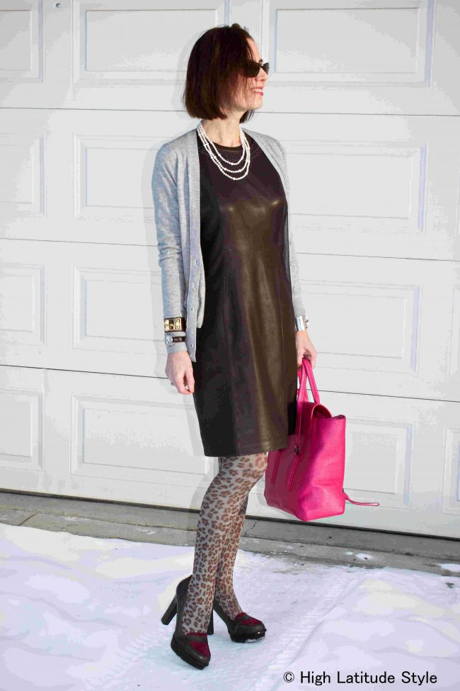 mature style blogger wearing a sheath dress with leopard print tights