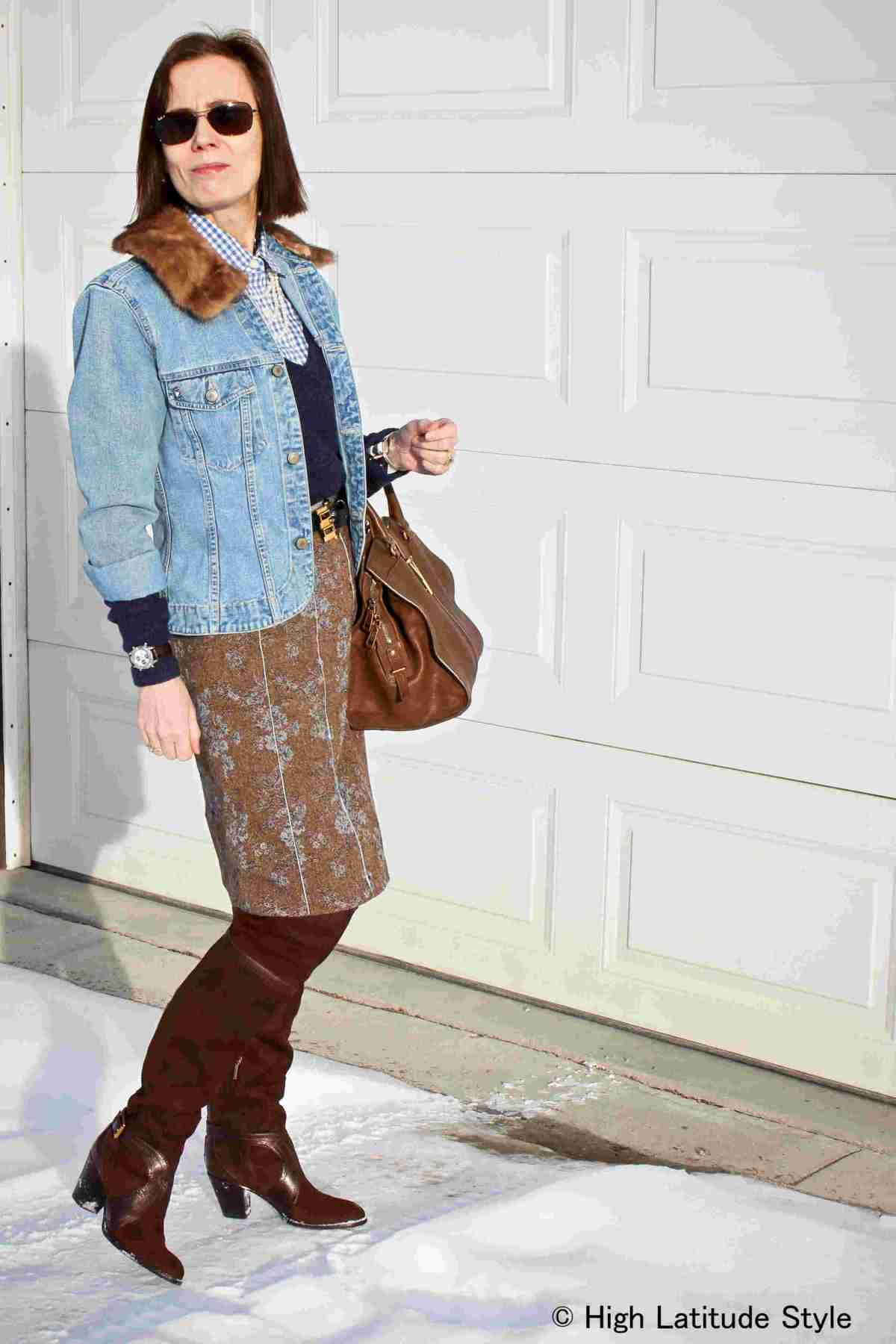 midlife blogger looking posh chic in a tweed skirt with denim jacket and over-the-knee boots