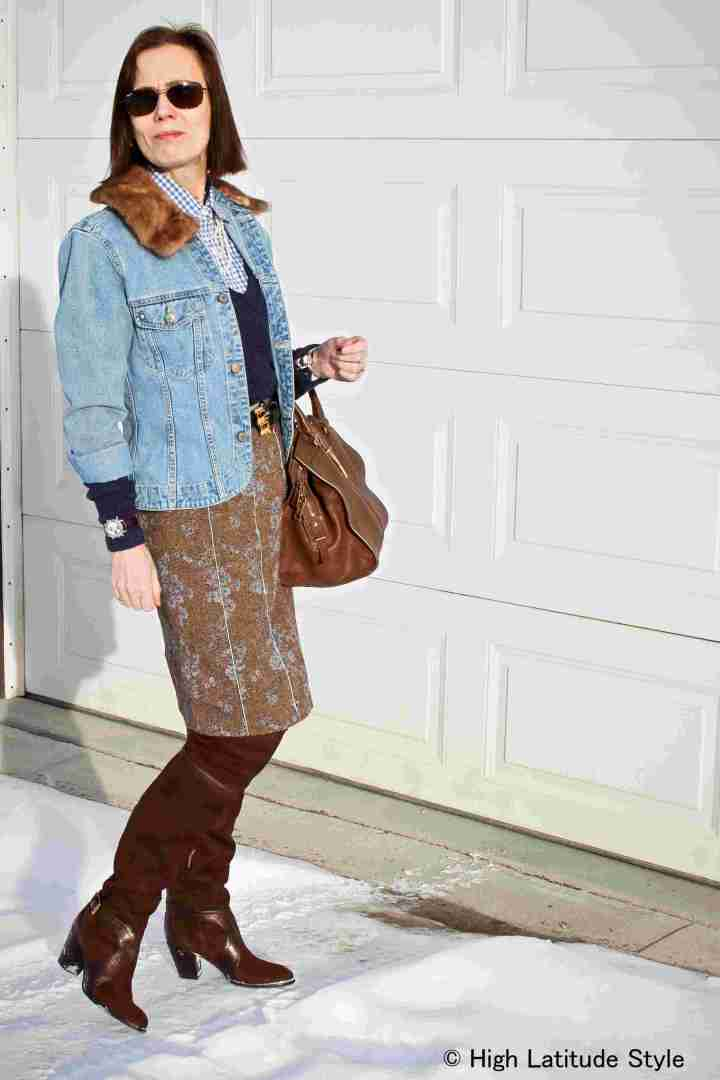 #fashionover40 midlife woman looking posh chic in a tweet skirt with denim jacket and over-the-knee boots