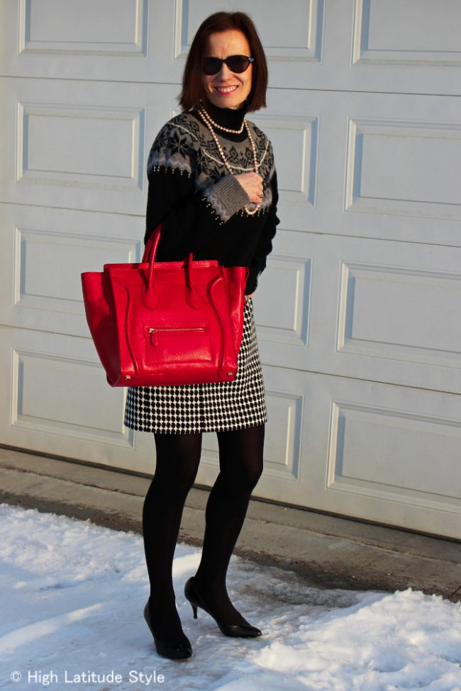 style book author in houndstooth sheath with Fair Isle sweater
