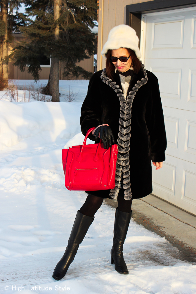 #fashionover50 mature woman in classic winter outfit with faux fur coat