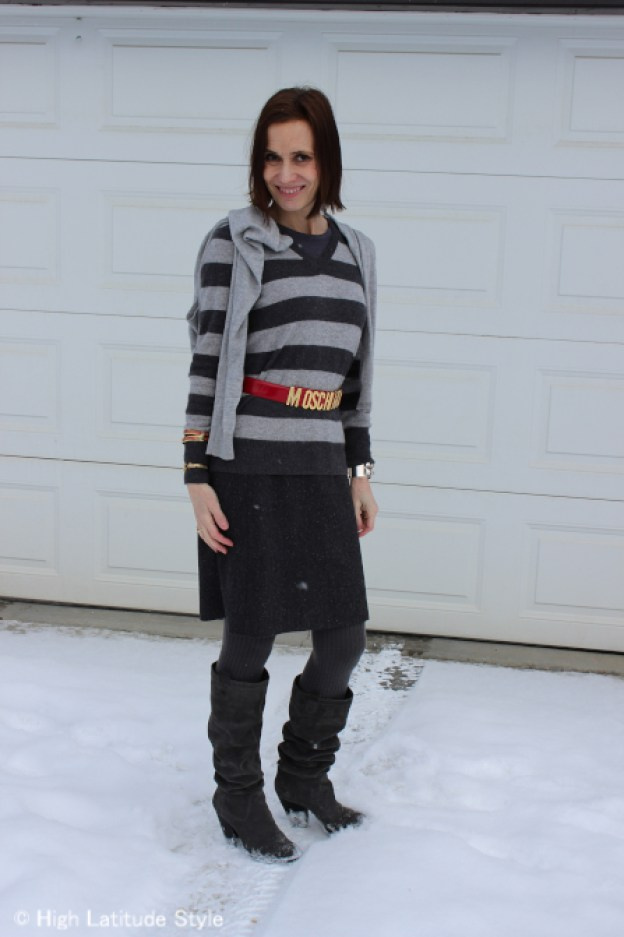 fashion blogger in winter office look in gray and red