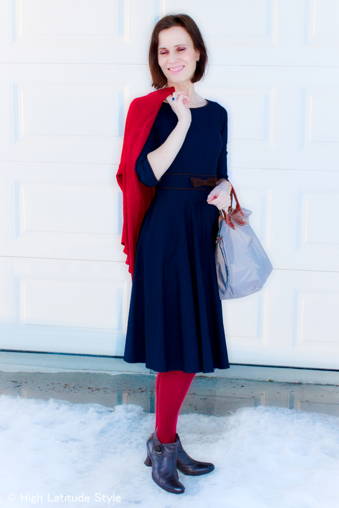 #over40Fashion mature woman in fit-and-flare dress with cardigan