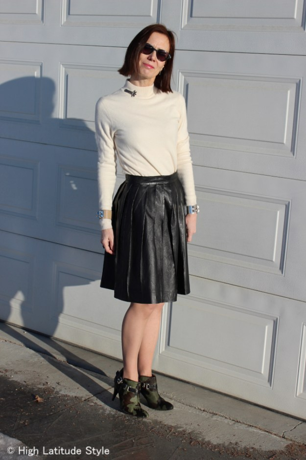 blogger in street style pleated leather skirt