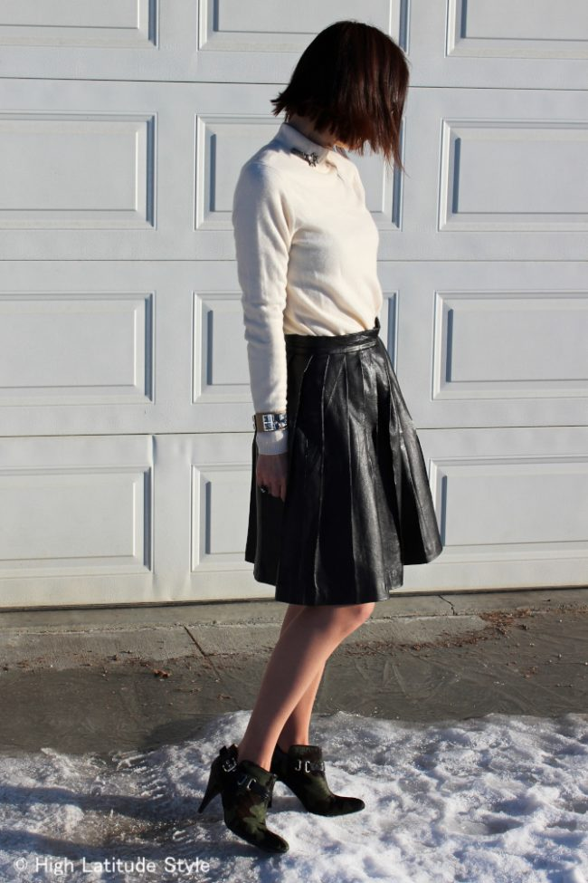 style influence in black and white look with camouflage booties, pantyhose