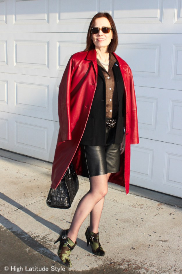 style book author wearing an unmatched ensemble of shorts and blazer