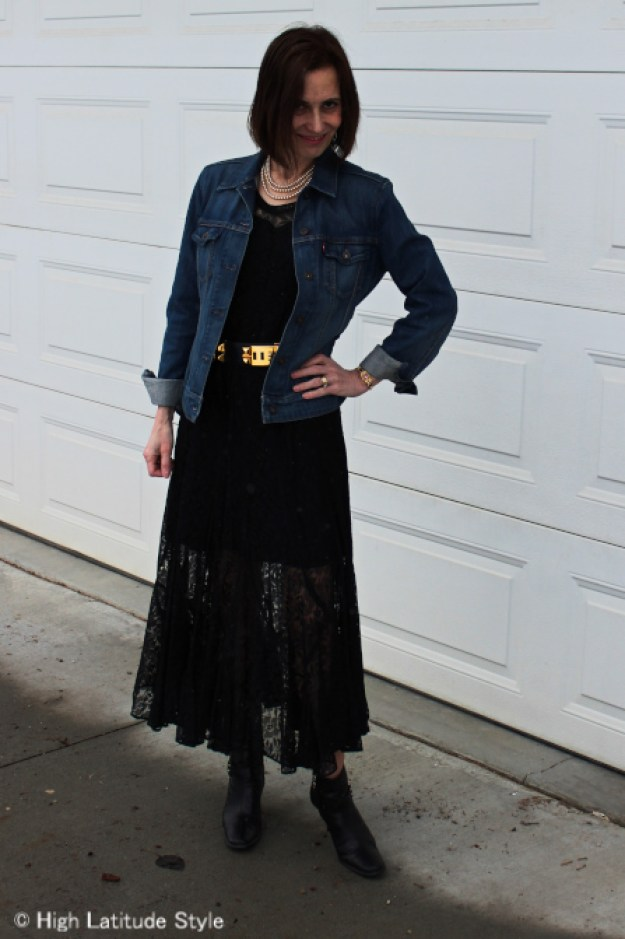 #over50fashion women in long black lace dress with jeans jacket