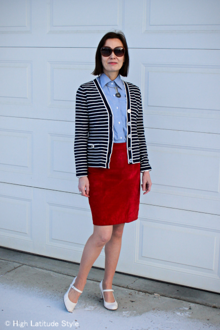 stylist rewearing the skirt with cardigan, shirt, pantyhose, Mary Janes