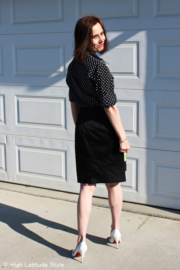 #fashionover40 woman in striped skirt with polka dot shirt