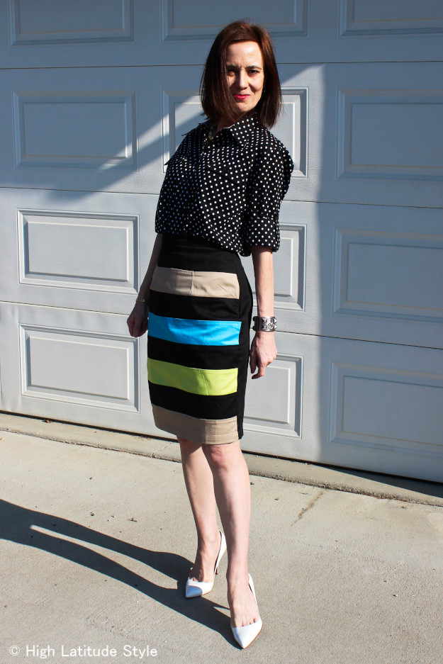 stylist in mixed print and pattern office outfit