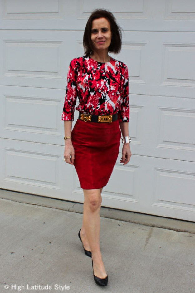midlife woman in work outfit with suede skirt and floral top