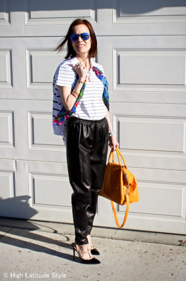 fashion blogger in a cool weekend look with leather joggers