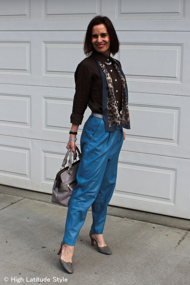 fashion blogger in wide leather trousers with sleek top