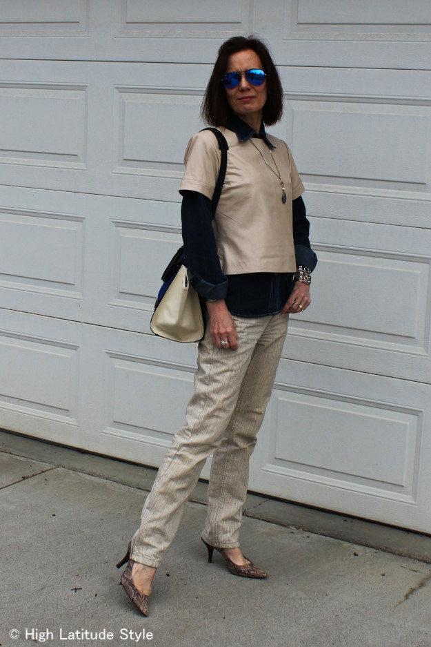Mature woman in neutral color work outfit