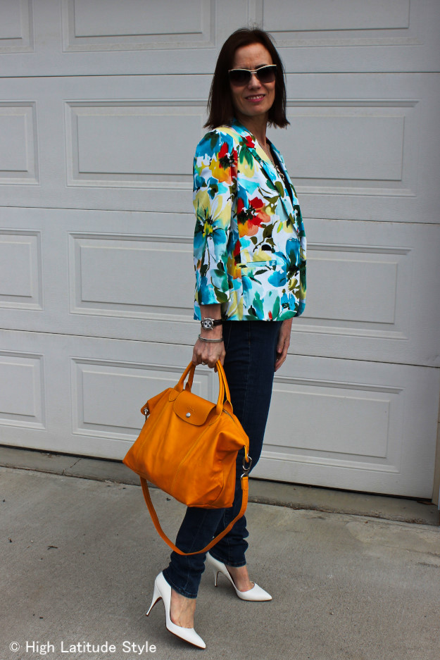 mature woman in skinnies with yellow bag