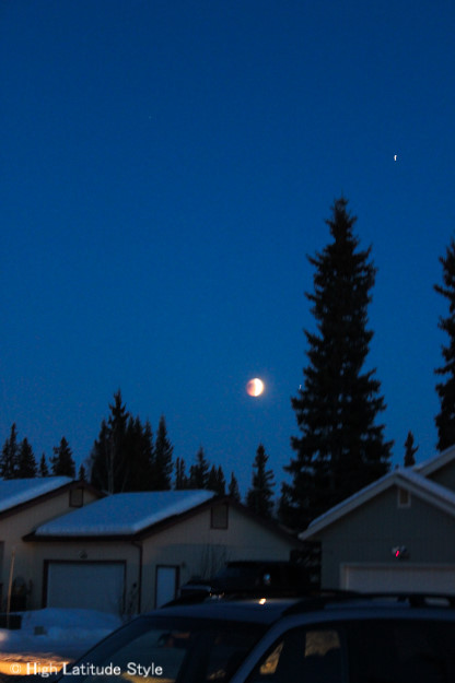 red Moon during lunar eclipse over neighborhood in College Alaska