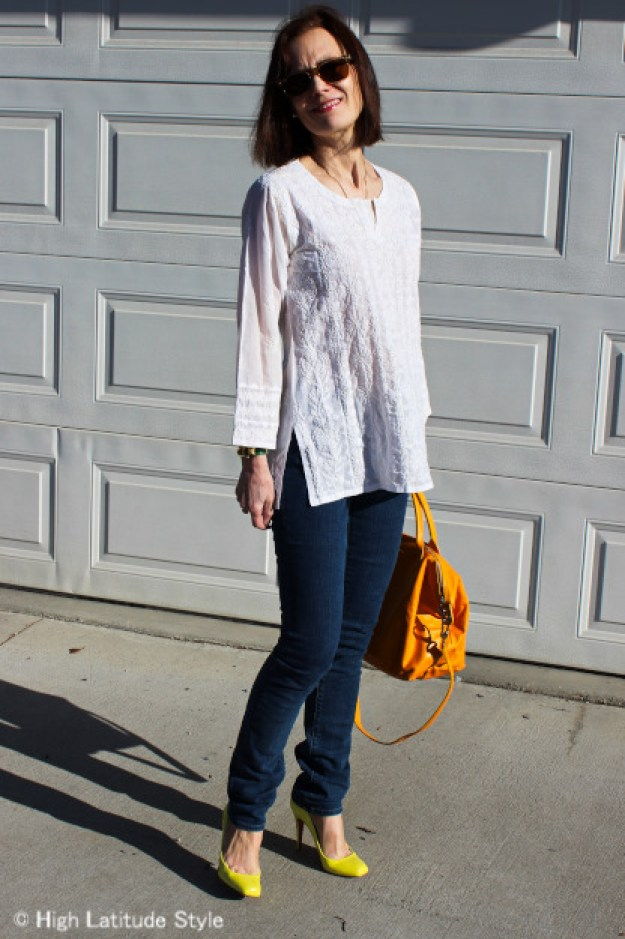 #styleover50 mature woman with skinnies and ethnic embroidered shirt