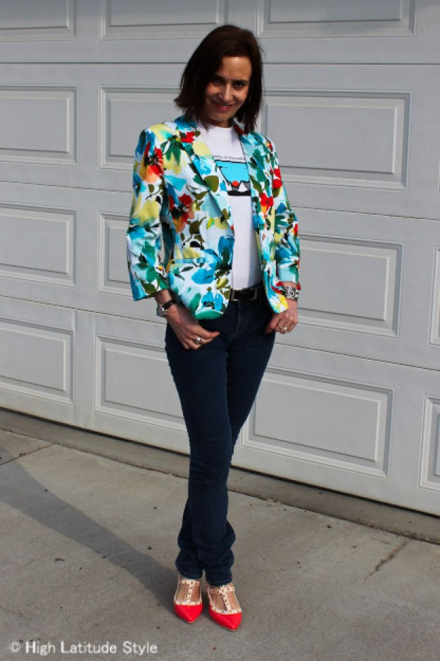 #fashionover50 woman in college T and floral blazer with consigned J Brand skinnies