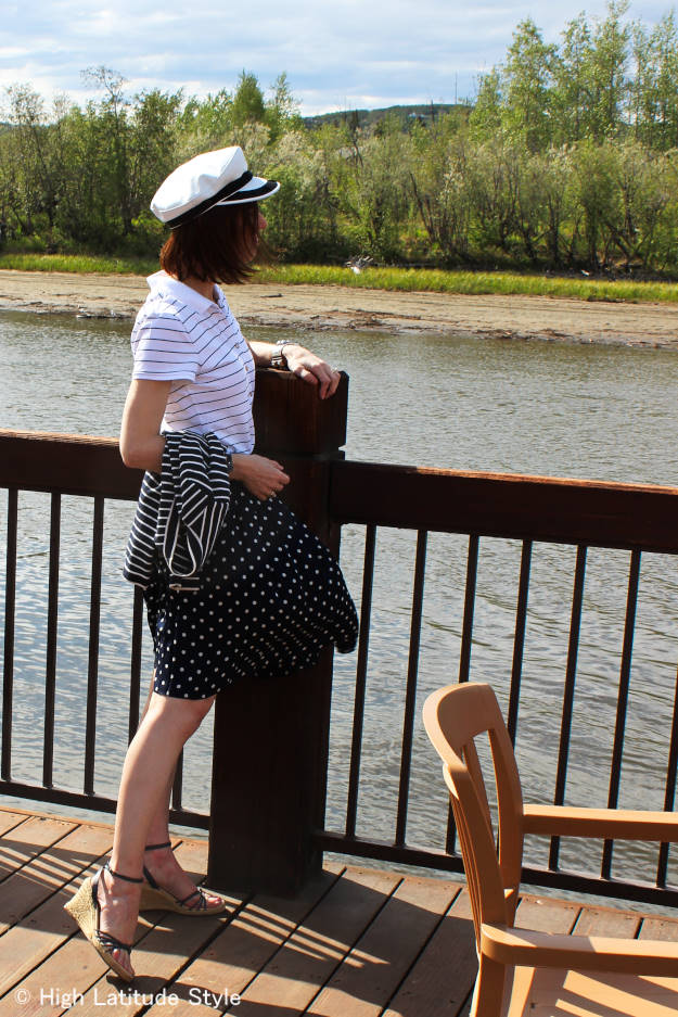 fashion influencer in maritime polka dots on a deck at the Chena River