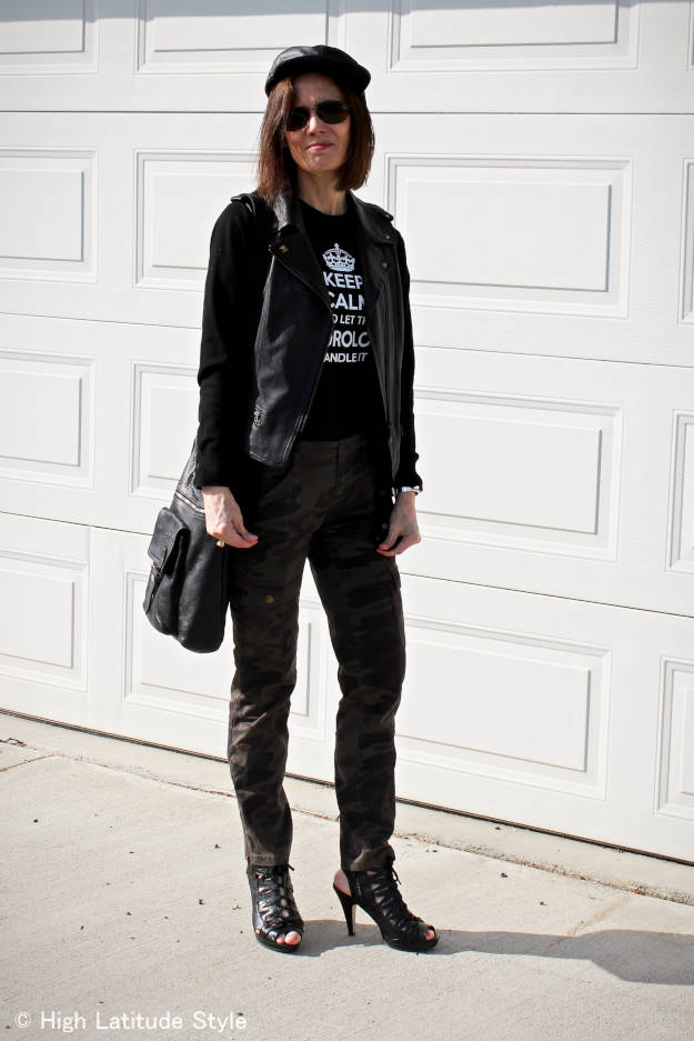 #fashionover50 woman in cargo pants and T-shirt with leather vest from sales