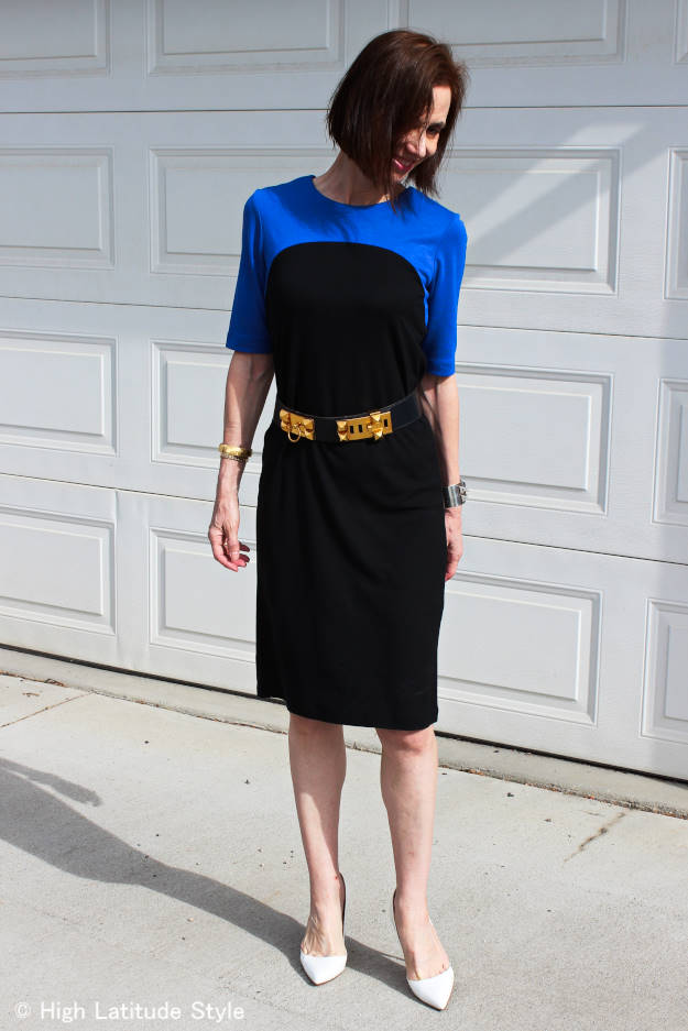 midlife woman wearing a straight cut color block designer jersey dress with with pumps