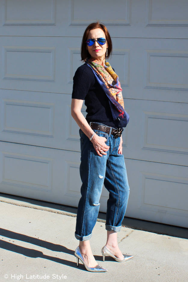 mature woman donning distressed jeans in a casual posh look