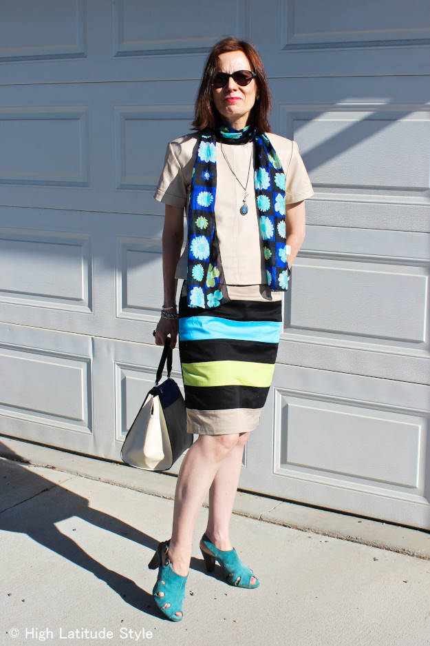 over 50 years old fashion blogger in leather top, floral print scarf and striped skirt