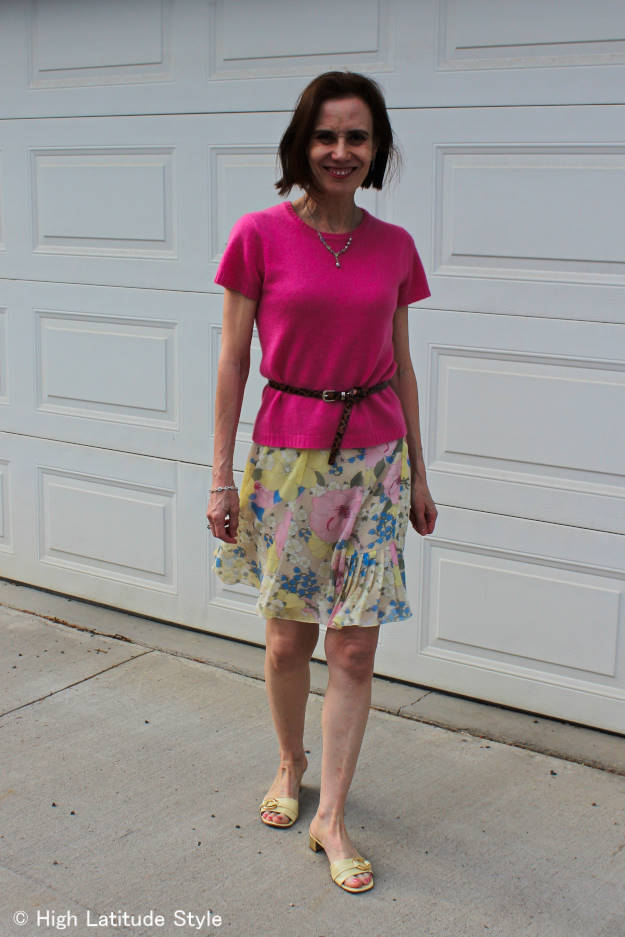 fashion blogger in floral skirt with pink sweater