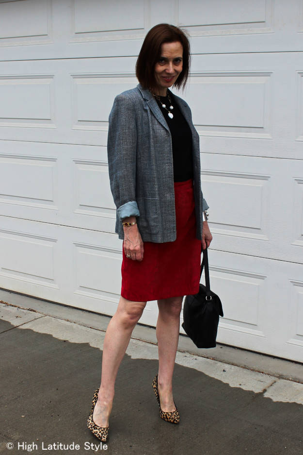 #fashionover40 woman in steel blue blazer with red skirt