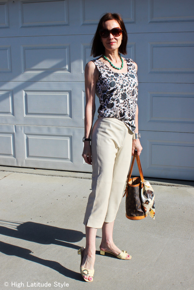 over 50 years old style blogger in leather Capri with floral Print Top