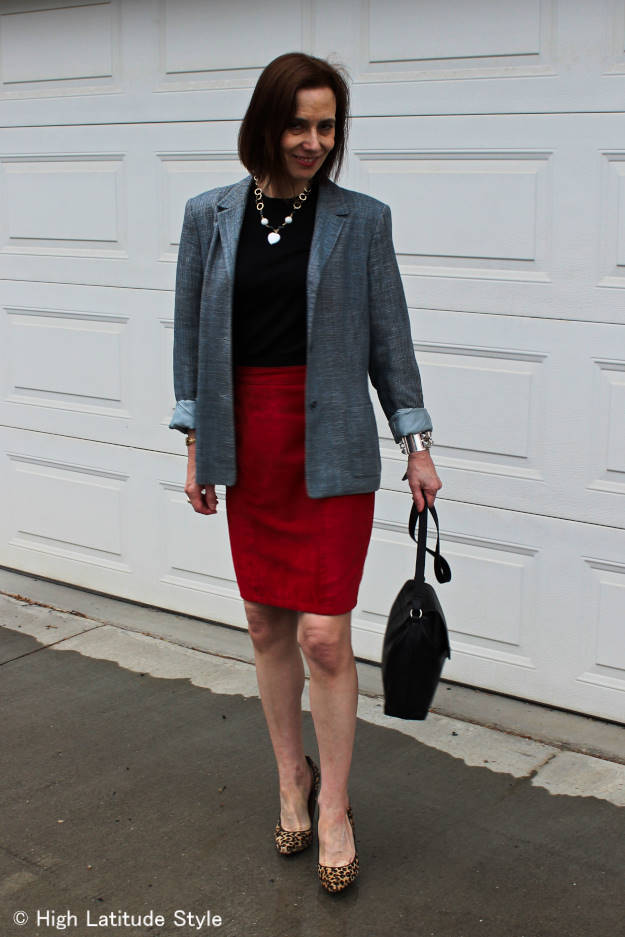mature woman in work attire of skirt, blazer top with pumps