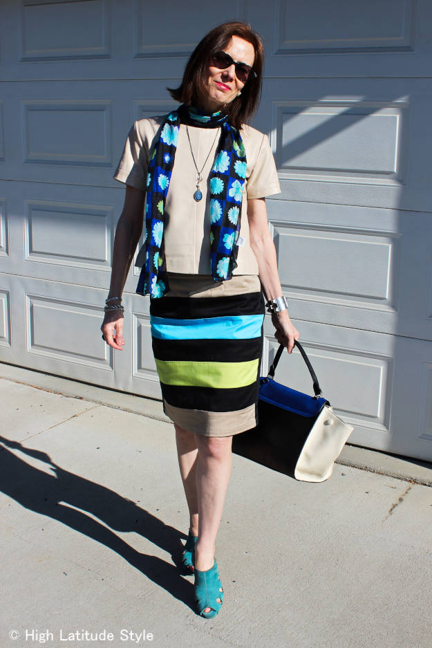 #over40fashion Style blogger wearing a silk scarf, bold striped eShakti skirt and leather top for a work outfit