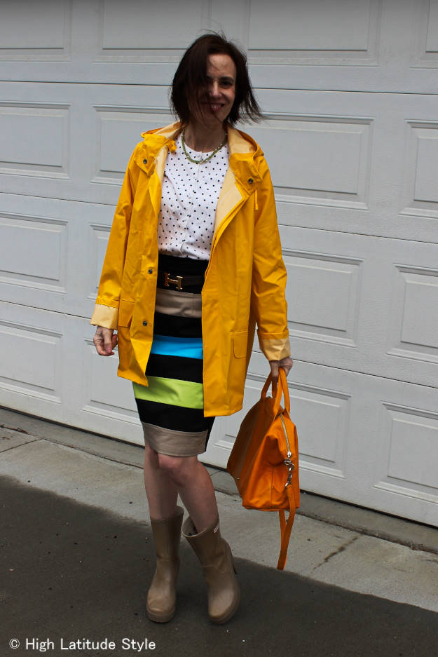 #fashionover40 woman wearing a skirt on a rainy day