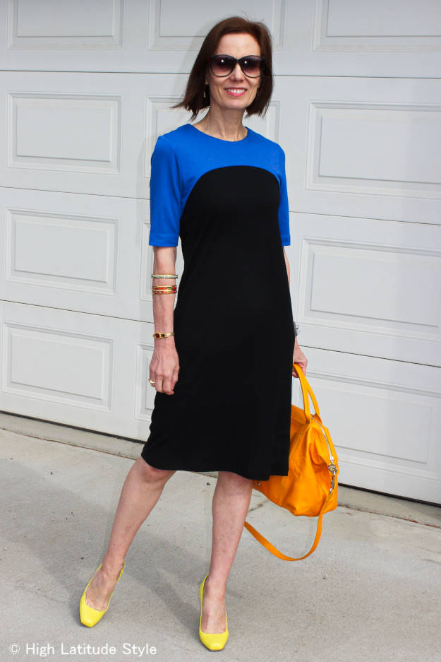 older woman in a Ronen Chen two-color jersey dress