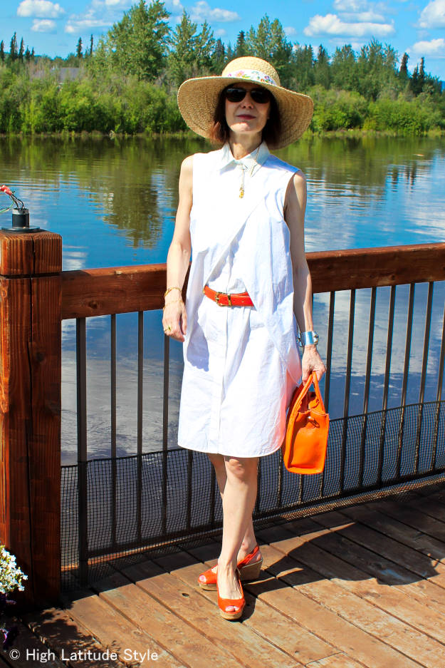 fashion blogger in American Classic white summer dress with straw hat outfit and orange sandals