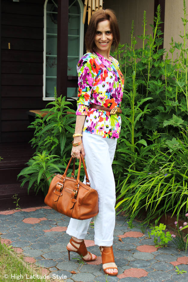 fashion book author in floral top with BF jeans and satchel