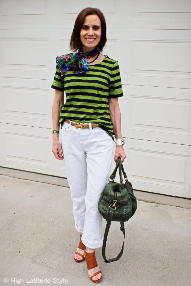 fashion blogger dressed for a sports event in colors similar to the green, white and blue of the team