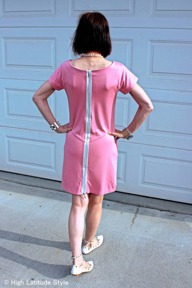 #styleover40 woman in pink jersey dress with sexy zipper