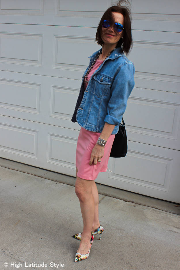 #fashionover40 woman in baby pink dress and tailored denim jacket