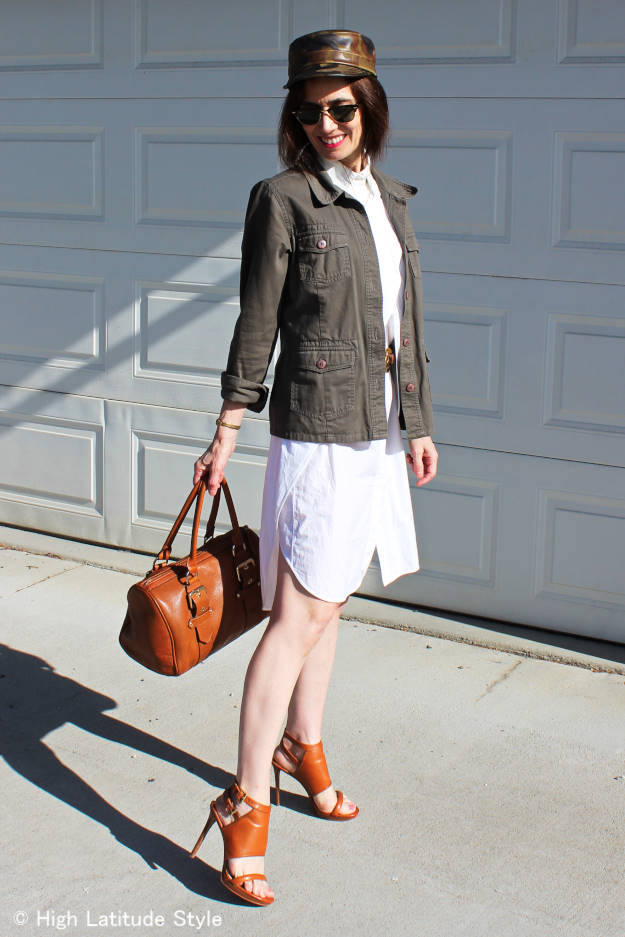 midlife fashion blogger in lwd with utility jacket and leather hat