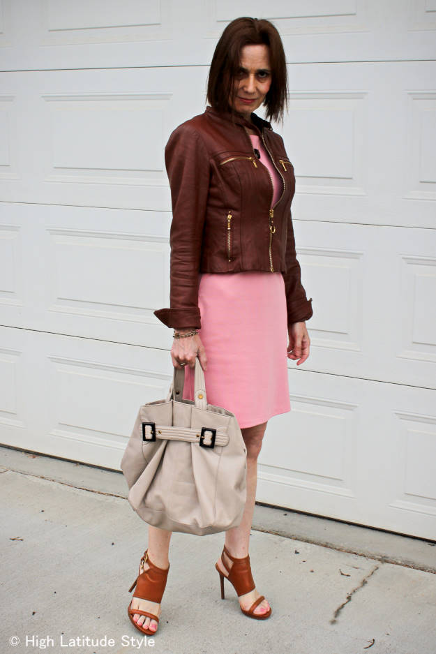 #streetstyleover50 woman in tailored leather jacket and pink dress