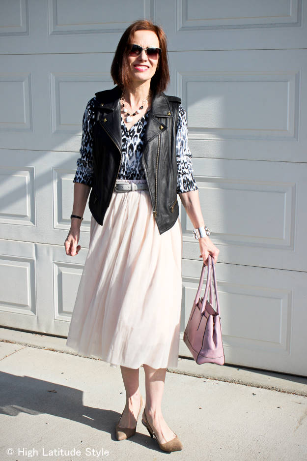 fashion blogger over 50 in mesh skirt with animal print top and motorcycle leather vest