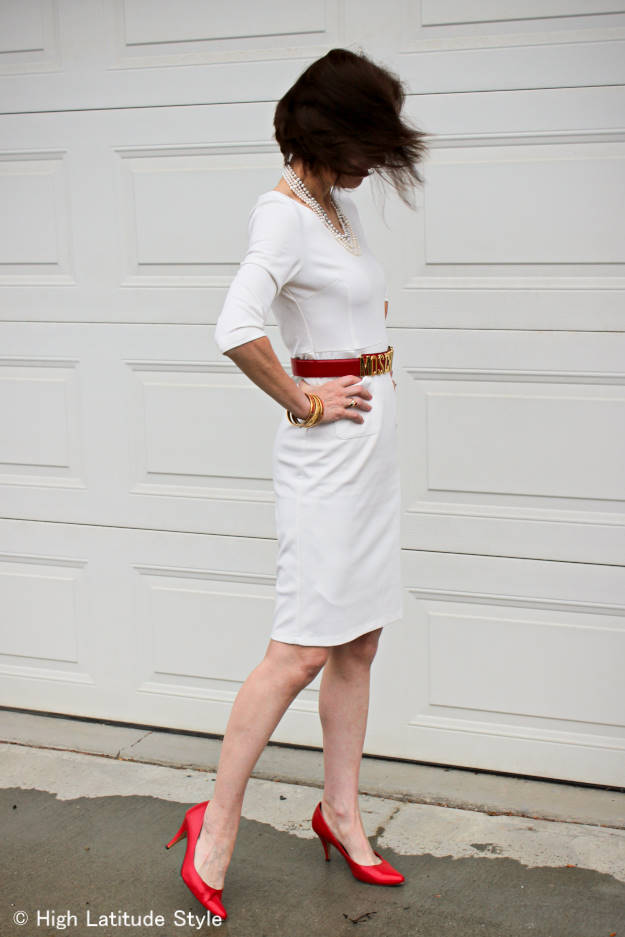 #fashionover50 mature woman in a summer sheath dress styled for autumn