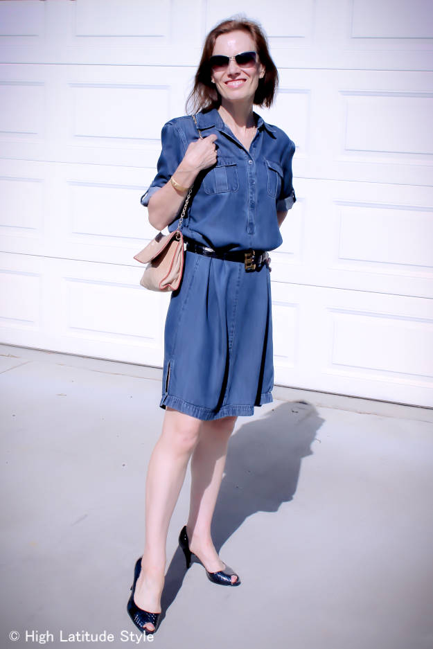 #fashionover50 fashion blogger Nicole of High Latitude Style looking posh casual in a denim dress