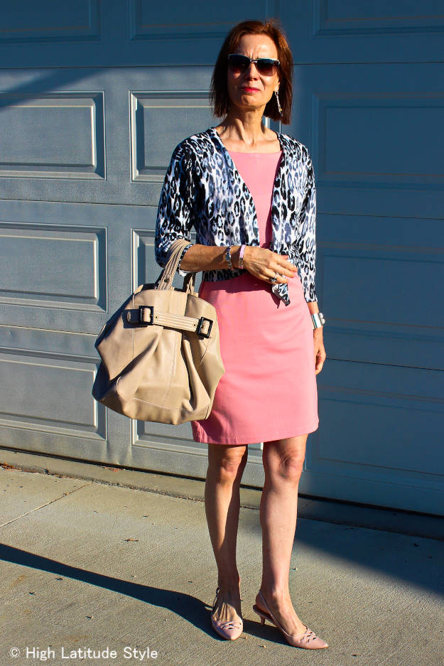 #fashionover50 mature woman in a baby pink dress with cardigan and slingback pumps